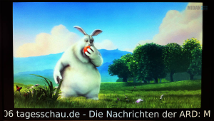 "Ein Foto aus dem Video ""Big Buck Bunny"" der Blender Foundation welches PECS in Full-HD Auflösung und Newsticker am unteren Bildschirmrand abspielt - von der MIDAN SOFTWARE GmbH."